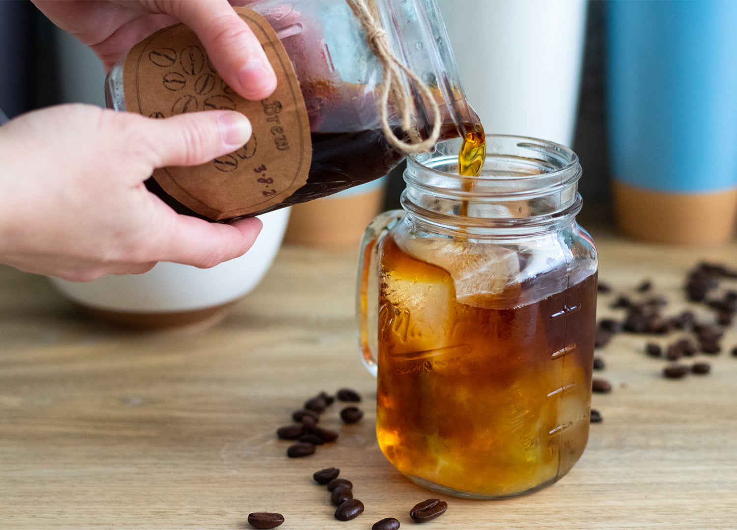 Pouring my fresh made cold brew over ice and a little filtered water in a rustic mason jar