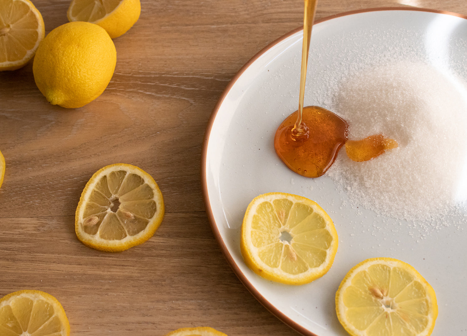 The ingredients for sugar paste shown on a Mora Ceramics Earl Grey dinner plate. Sugar, honey, and lemons.