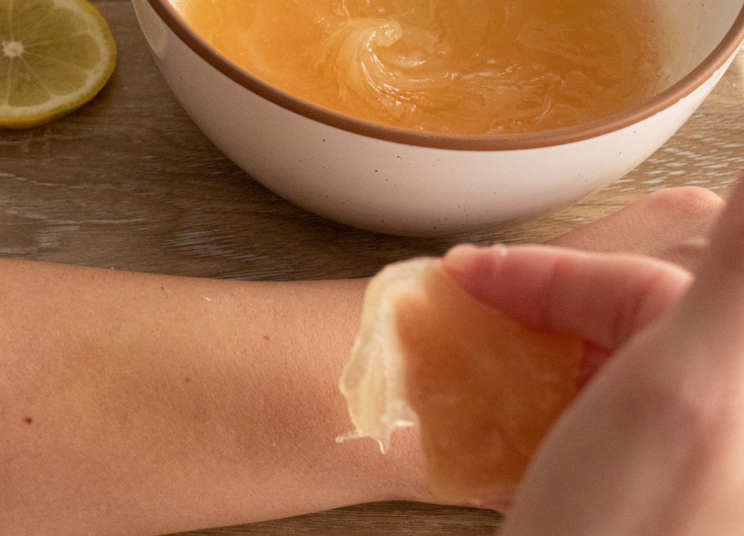 Flick in a horizontal motion with the direction of the hair growth, keeping the sugar wax toward your finger tips.