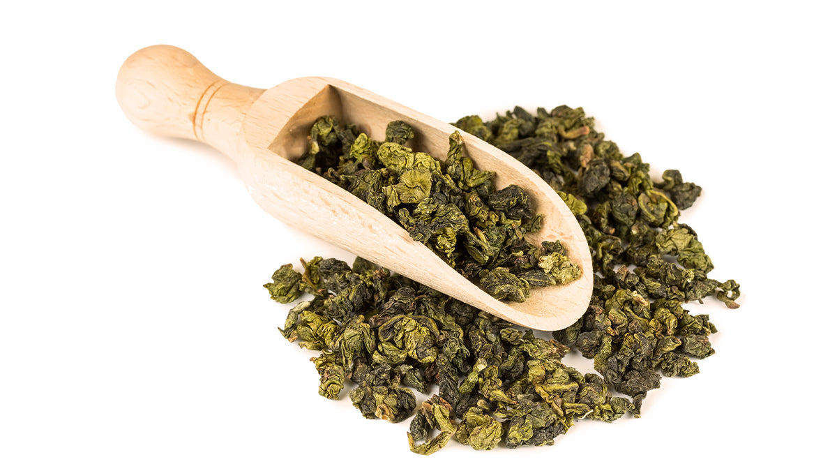 Tieguanyin oolong tea with a wooden scoop