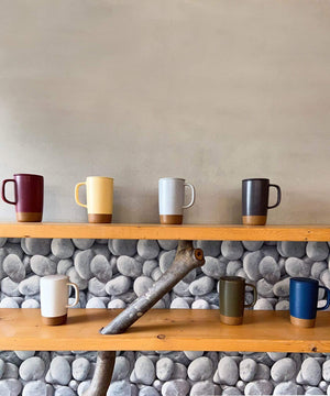 Mora Ceramics tea mugs come in a variety of colors including merlot, yellow, grey, black white, green and blue