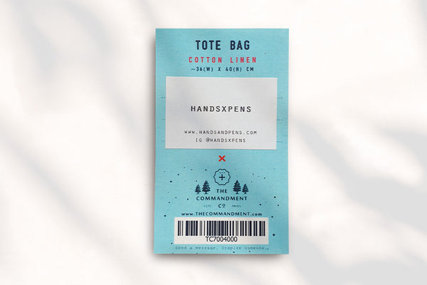 Collab+ tote bag design with Designers name printed on packaging label