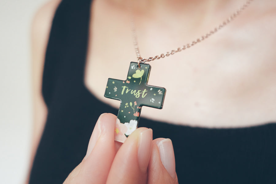 Acrylic forest green cross keychain. Rose gold plated stainless steel chains. Pendant height 2.7cm length 2.1cm. Chain length 42-46.5cm.