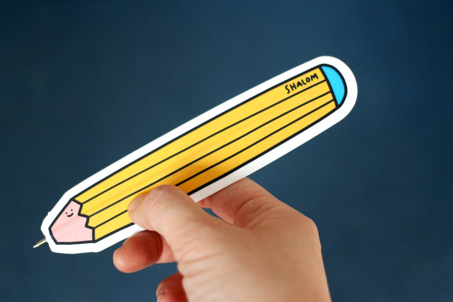 Yellow bookmark pen with word shalom close up of cartoony design