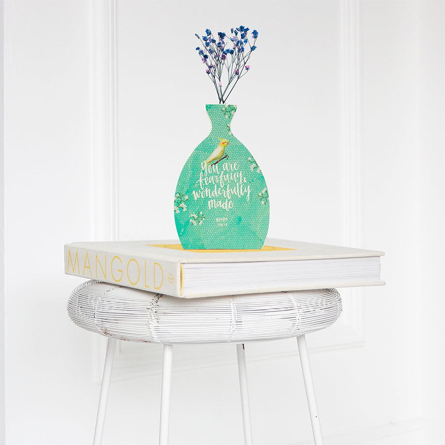 Wooden vase in the shape of a vase. With leaves details and white letter typography of bible verse 'you are fearfully and wonderfully made'. Decorated with dried blue and pink baby's breath. Great aesthetic home decor ideas