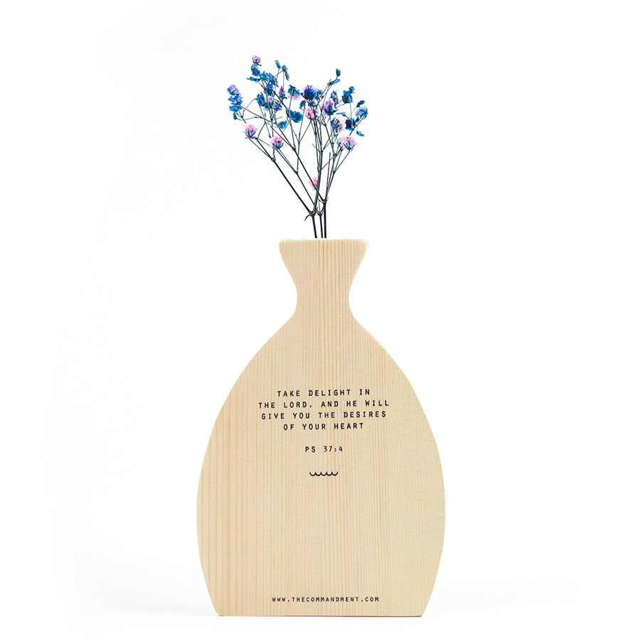 Wooden vase with blue and pink baby's breath