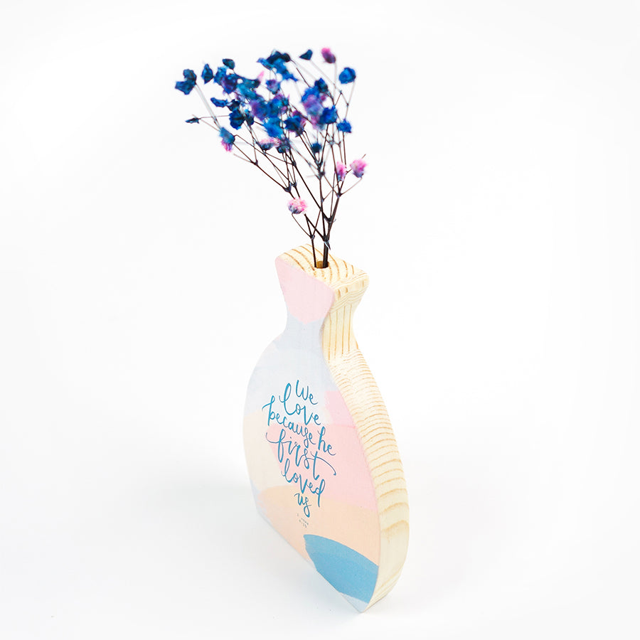 Wooden vase in the shape of a vase. Abstract designs and blue letterings