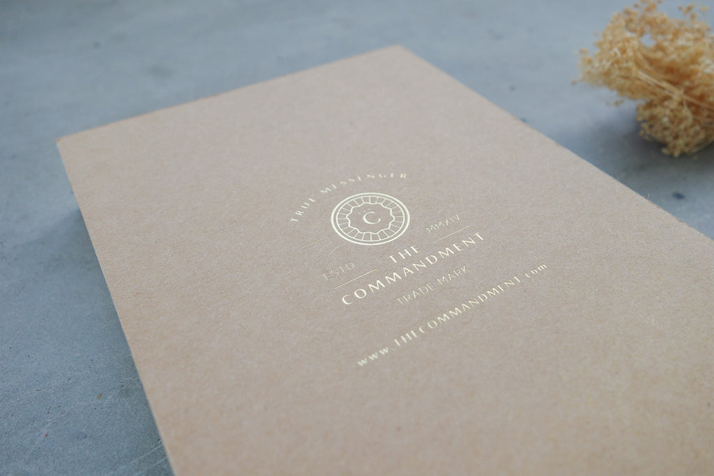 The logo on the back of the notebook is gold stamped with the commandment co logo and website
