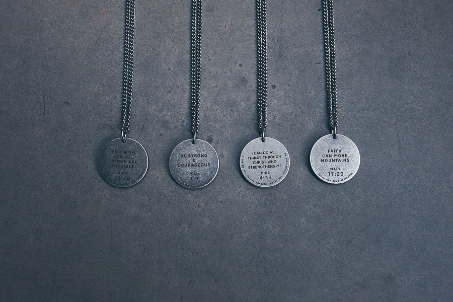 Various round gunmetal necklaces. Meaningful uplifting messages we should engrave to our heart.