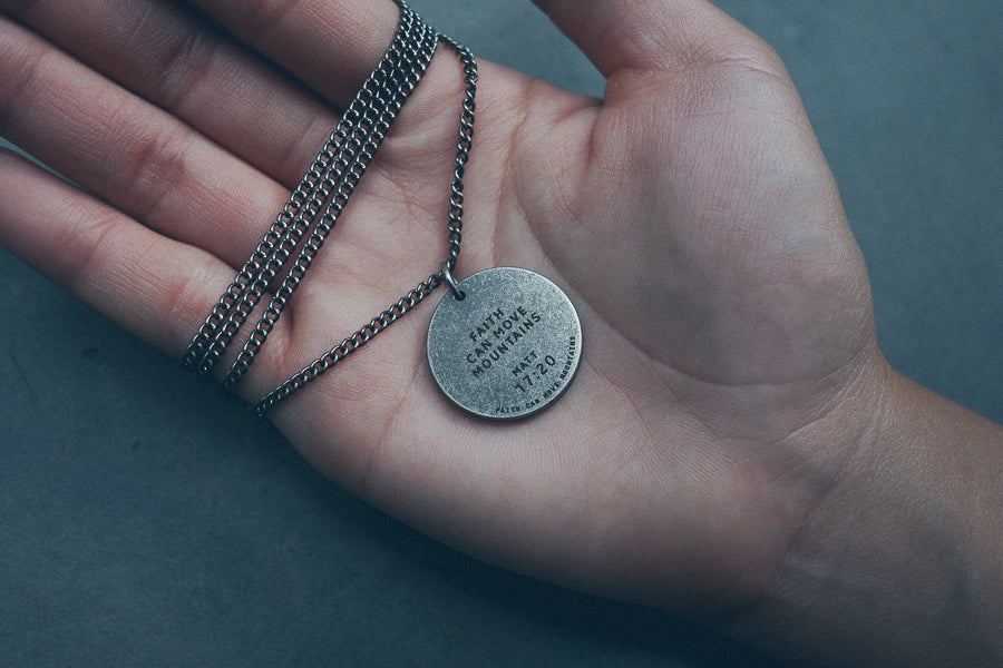 Faith can move mountains engraved on gunmetal round necklace. Beautiful fashion necklaces