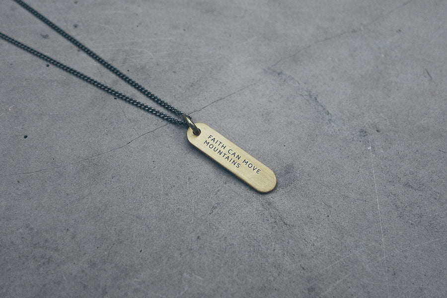 Military inspired brass bar dog tag necklace. Comes with brass key ring to be used as key chain. Measurement: pendant 4cm height x 1cm width. 63-68cm adjustable chain. Customisation available but they will be in capital letters.