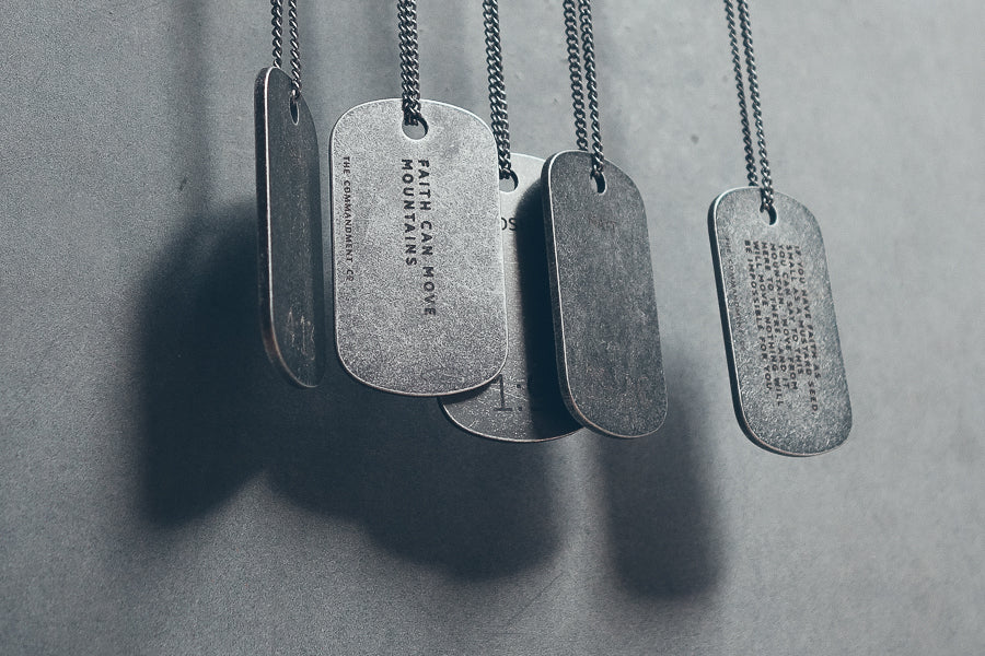 Gunmetal necklaces with meaningful messages engraved on it.