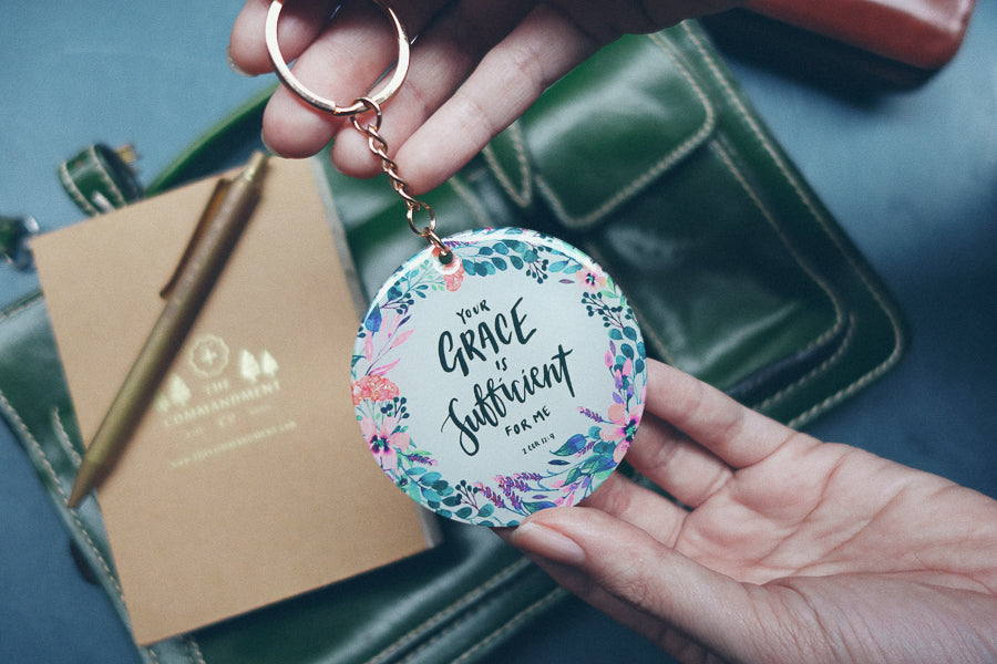 Hand holding Inspirational keychains by The Commandment Co