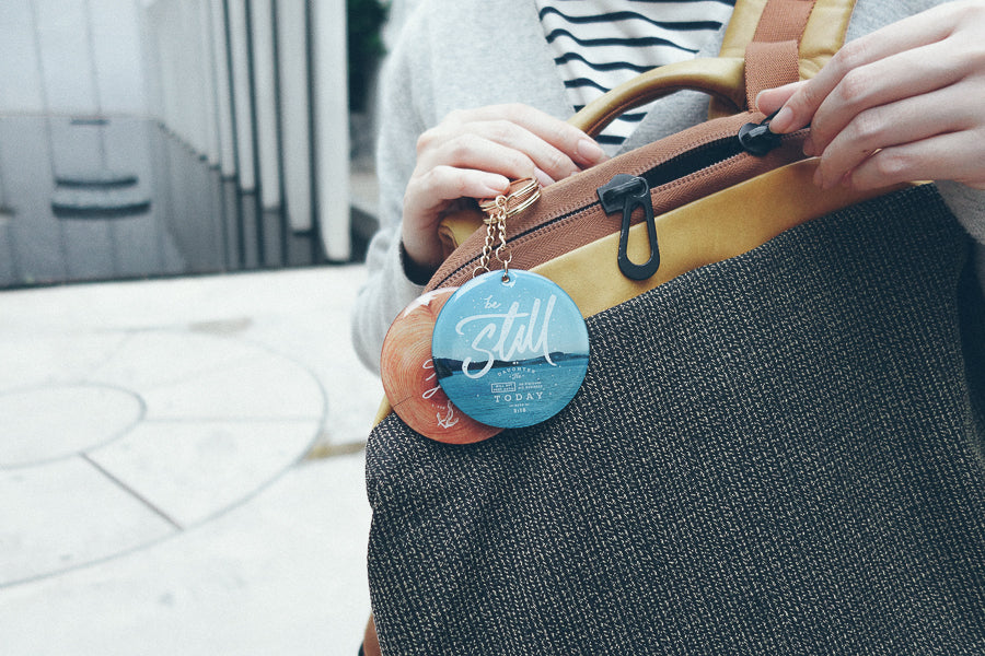 Two circle keychains hung on bags. Creative accessories.