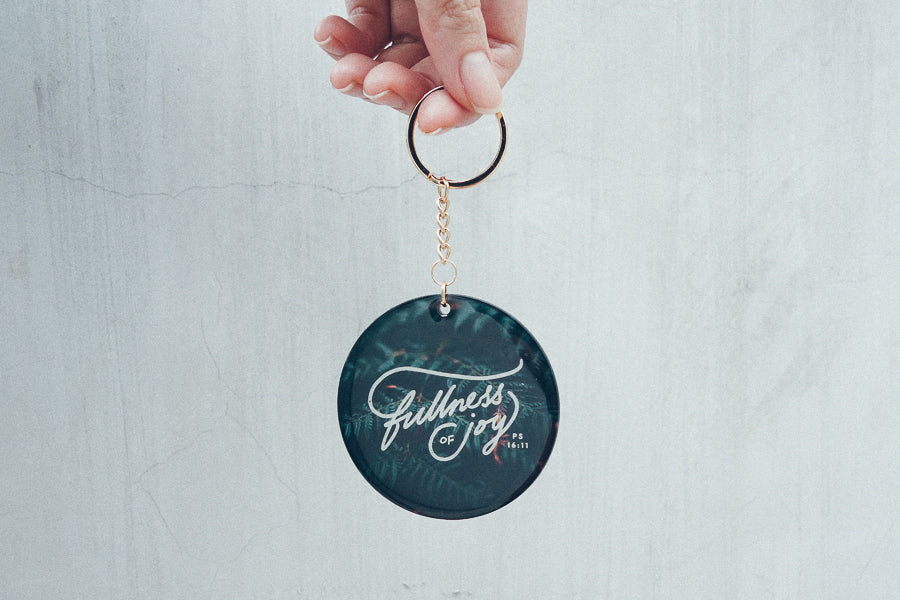 Fullness of joy white font lettering dark blue acrylic keychain designed by The Commandment Co