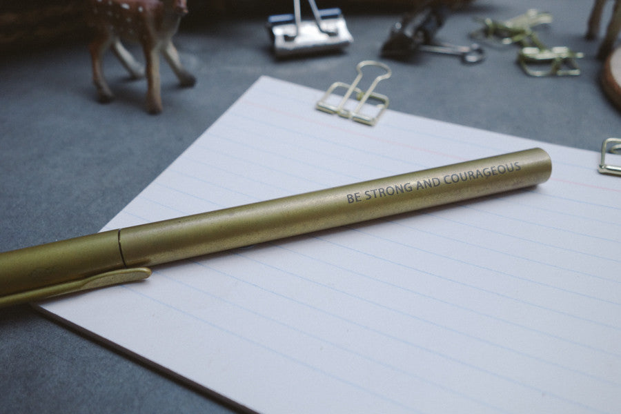 Be strong and courageous engraving on brass pen will motivate the recipient throughout the day