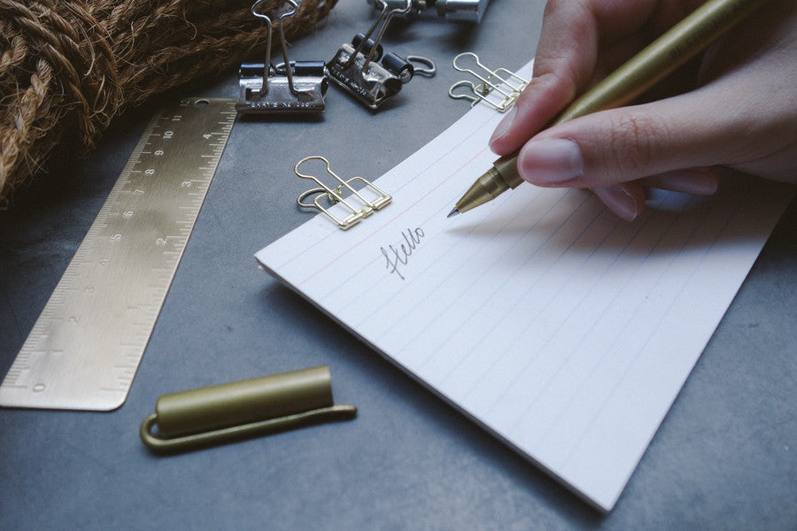 Close up of smooth writing by the timeless brass pen. Ageless gift that will impress anyone special.