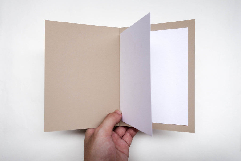 Blank white paper in the greeting card for writing birthday wishes..