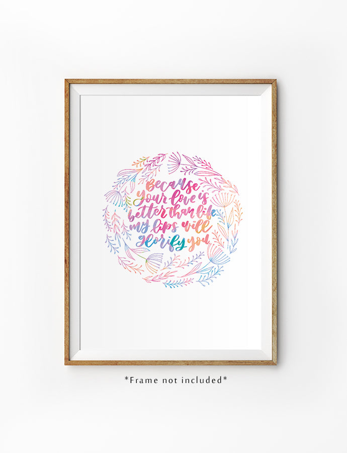 Poster featuring colourful pastel soft wreath flowers and bible verses from Psalm 63:3 is hung on the wall in a gold photo frame.