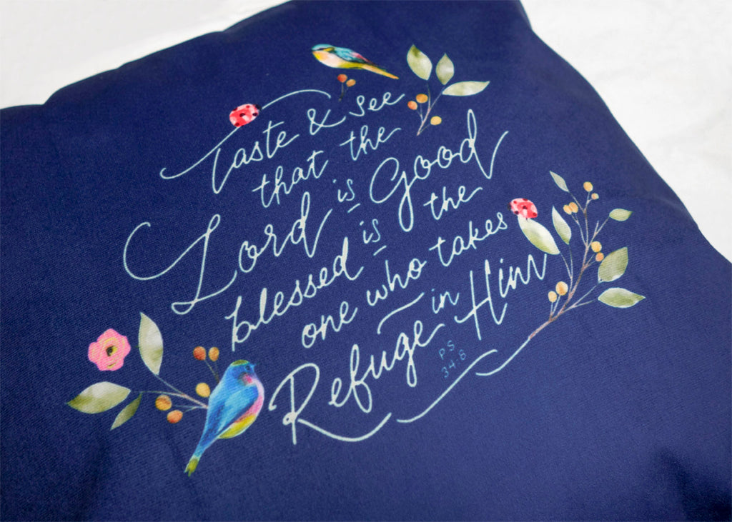 Close up picture of the front design blue bird details and white font lettering. Calligraphy art ideas.