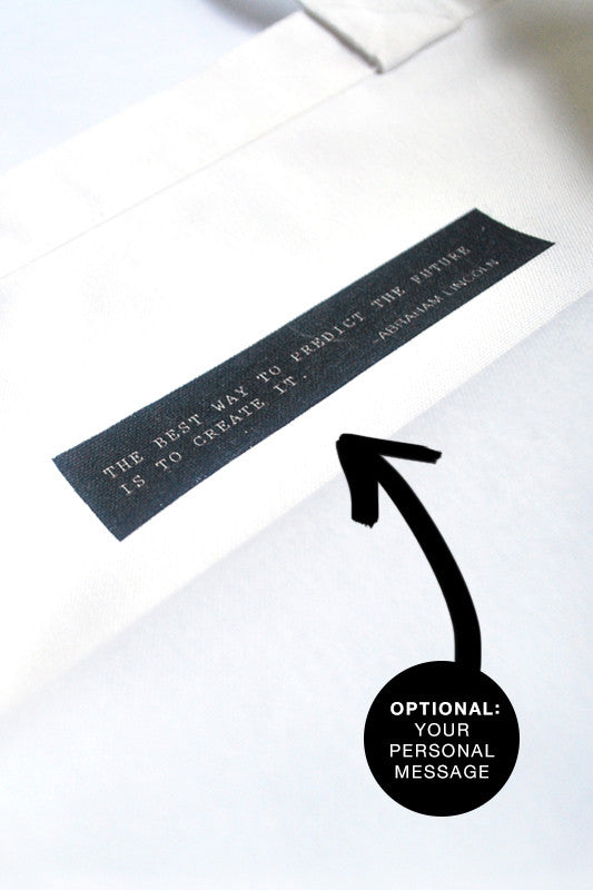 The personal message inside the bag is printed on the bag. The white words on black background can include a quote and a writer.
