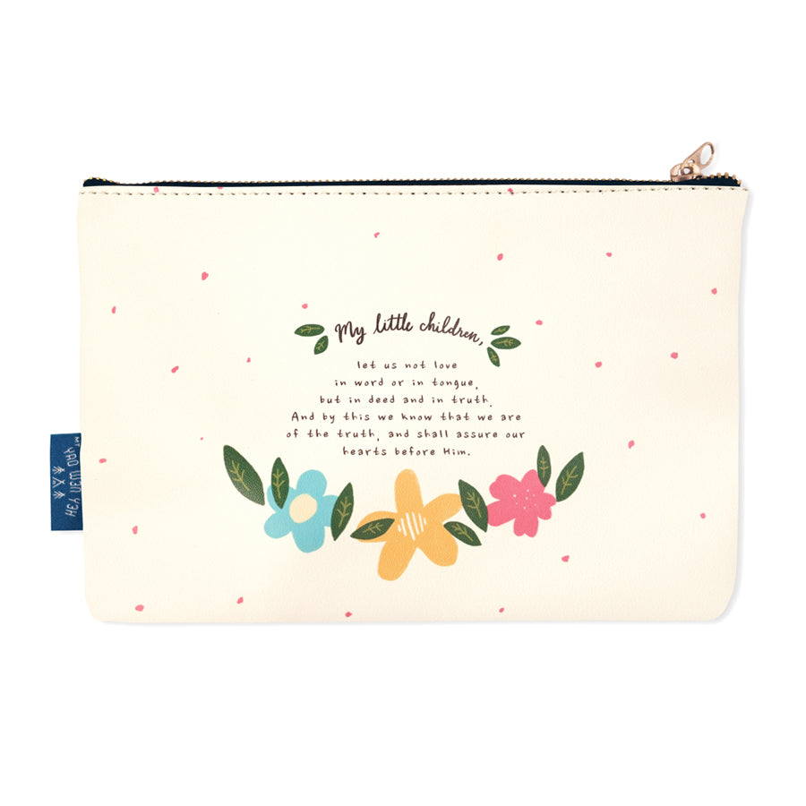The back of the pouch is cream and features the whole verse, with flowers and polkadots designs.