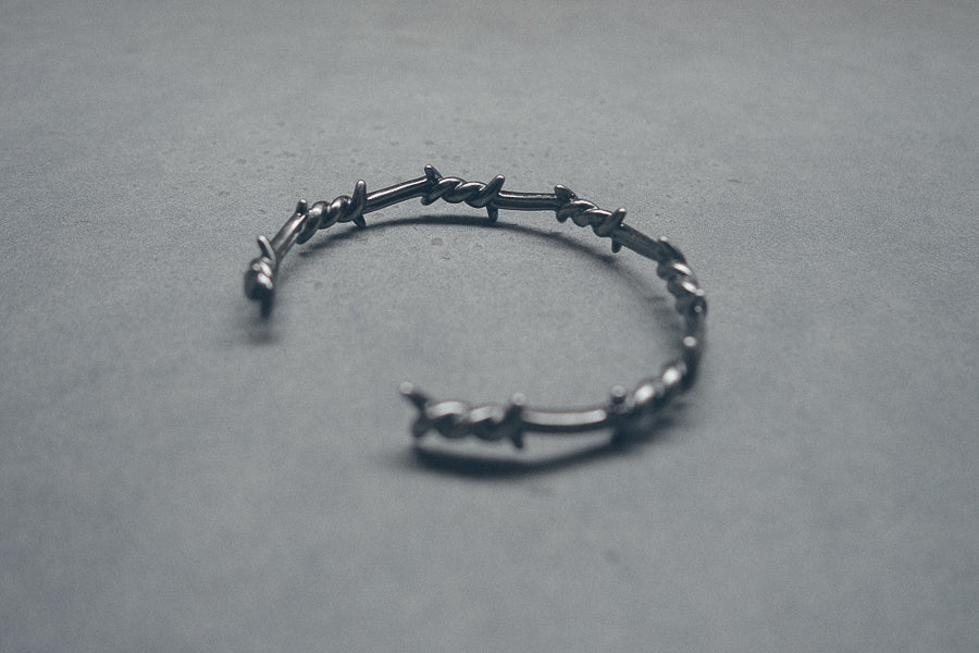 Inspired by military gunmetal barbed wire fence.