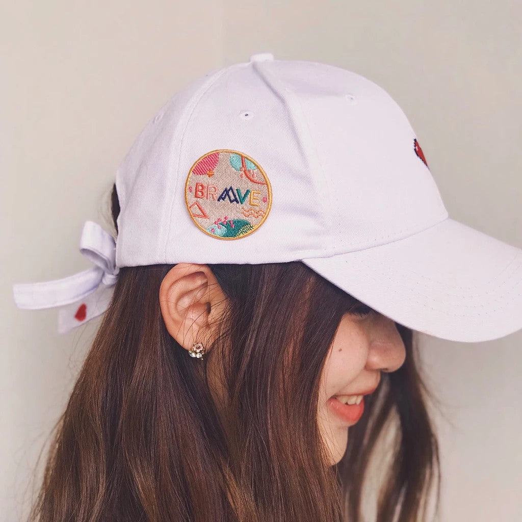 The pin can be attached to caps to make a cute fashion accessories.