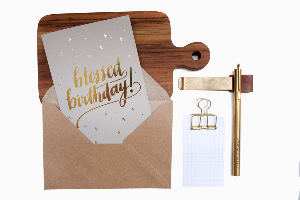 blessed birthday greeting card with envelope. 270 gsm paper  Available in 3 colours: Grey / Sand / Blue  Comes with envelope and plastic wrap  Design and logo in shiny gold  Designed and printed in Singapore