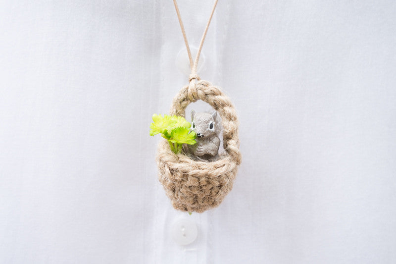 Cute squirrel necklace in an acorn with leaves