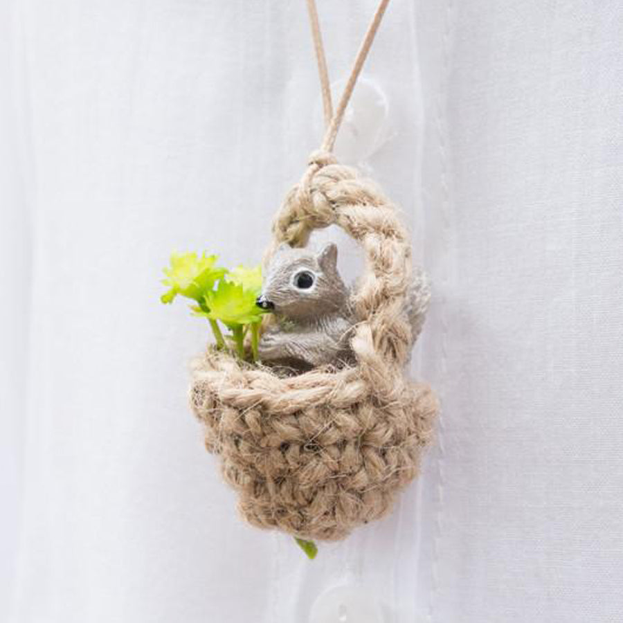 Praying squirrel necklace. A cute squirrel in an acorn praying.