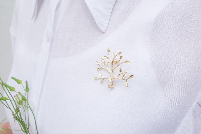 Fruitful tree pin used as brooch gives a delicate touch to any plain shirt.