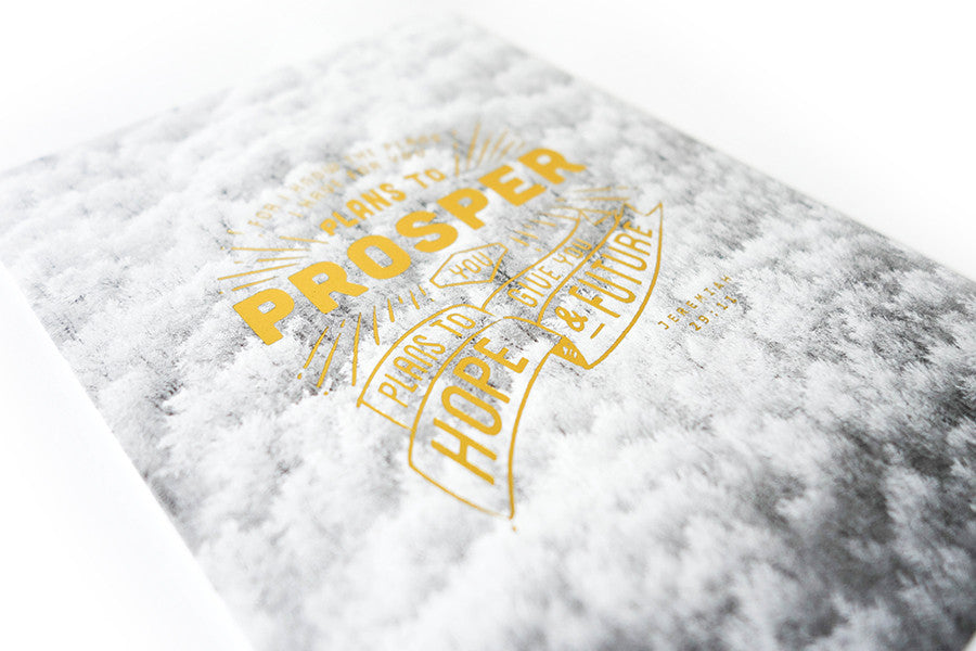 Cloudy background and gold stamped word adds to the aesthetic of the card.