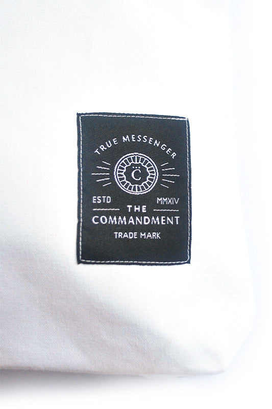 Close up of small The Commandment Co logo at the bottom of the tote bag. Christian gift store for all occassions.