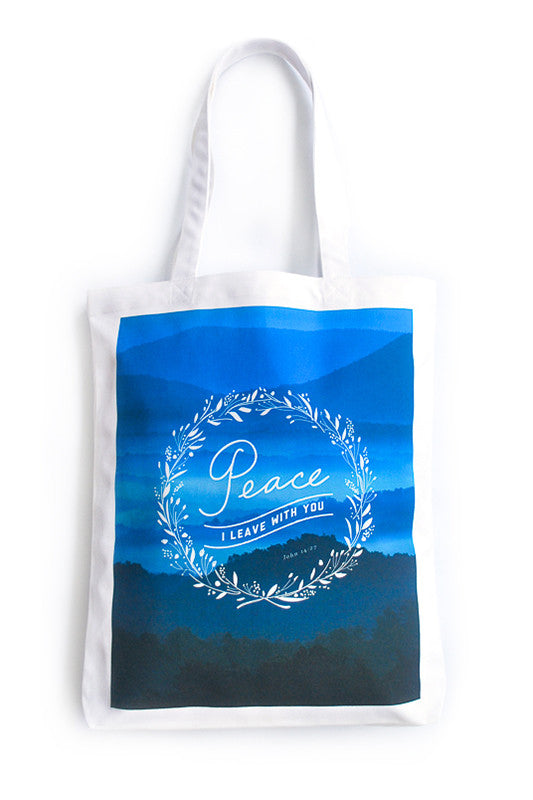 Tote bag made of 100% organic cotton from India. Features 'Peace I leave with you'.