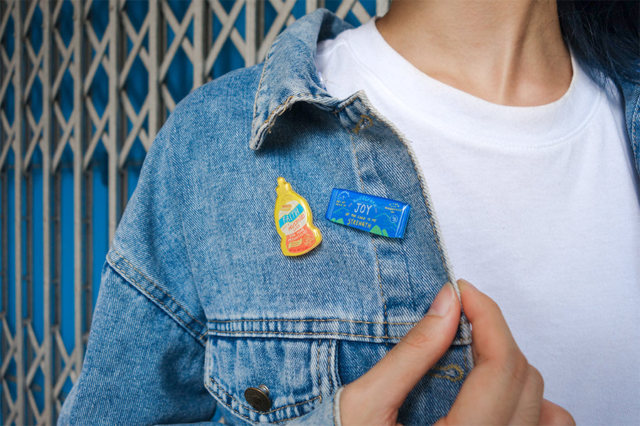 Carry a little positivity wherever you go. Wear the pins out proudly as part of your outfit ensemble.