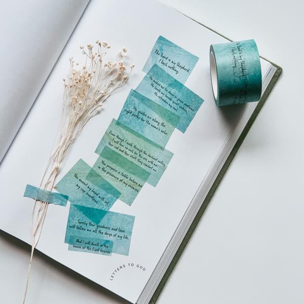 Washi Tape used to decorate a plain white page and a spruce of dried flowers in the journal