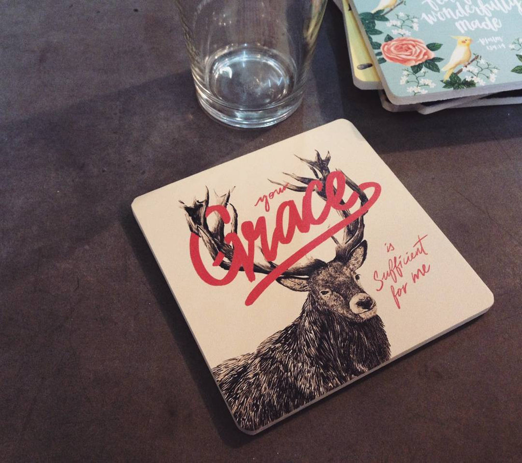 "10cmx10cm wooden coaster with a deer printed and the encouragement bible quote ""your Grace is sufficient for me""."