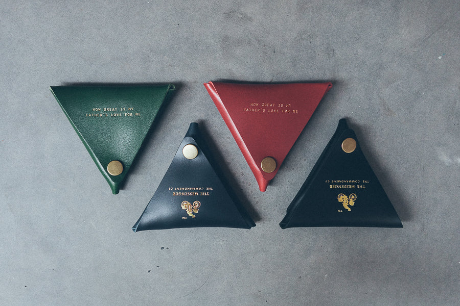 Leather triangular coin pouch can fit into your wallet