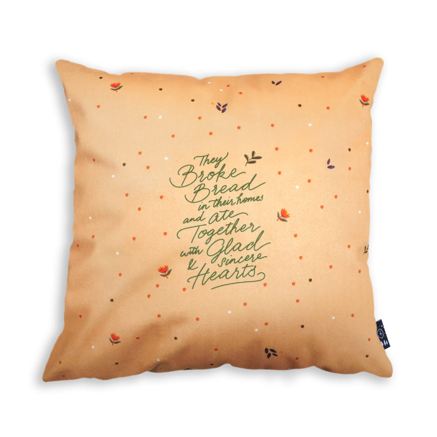 Premium 45cmx45cm pillow cover made of thick super soft velvet, light orange with flower designs. With hidden zip feature. Features verse 'They broke bread in their homes and ate together with glad and sincere hearts'.