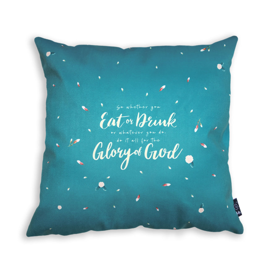 The back of the cushion cover features petals design on light blue background and the verse