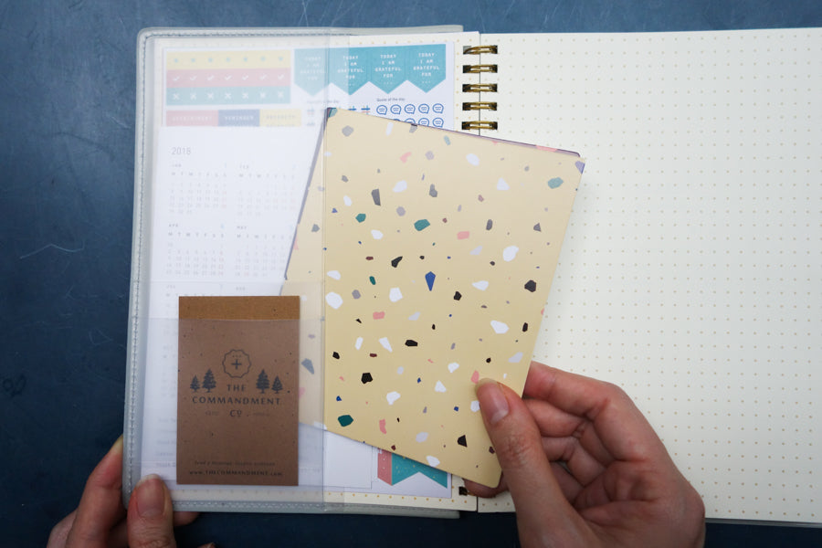 There is a pocket in the planner to keep the sicker and terrazzo sheets