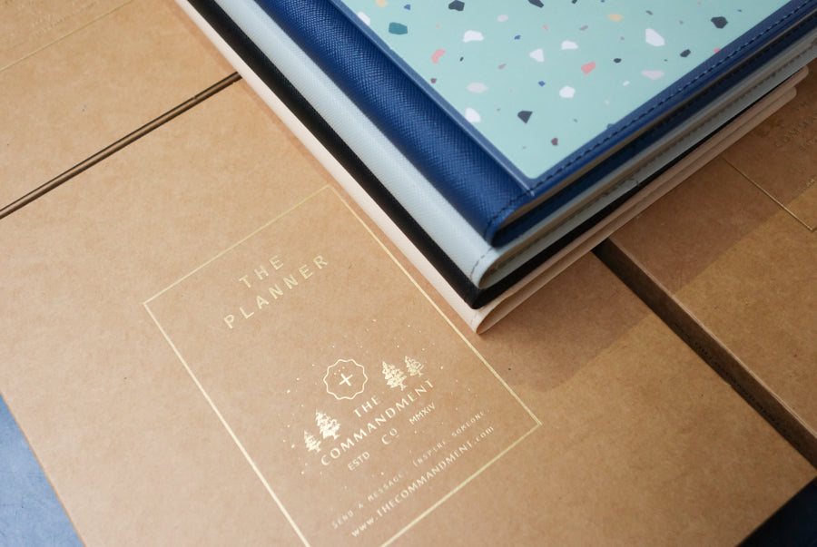 Terrazzo design on blue notebook