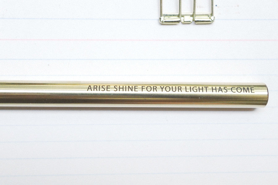 Brass pen. Length (with cap on): 14.3 cm Diameter: 0.9 cm. With engraving: Arise shine for your light has come.