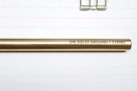 The-Commandment-Co-Brass-Pen-on-solid-ground-i-stand-engraving