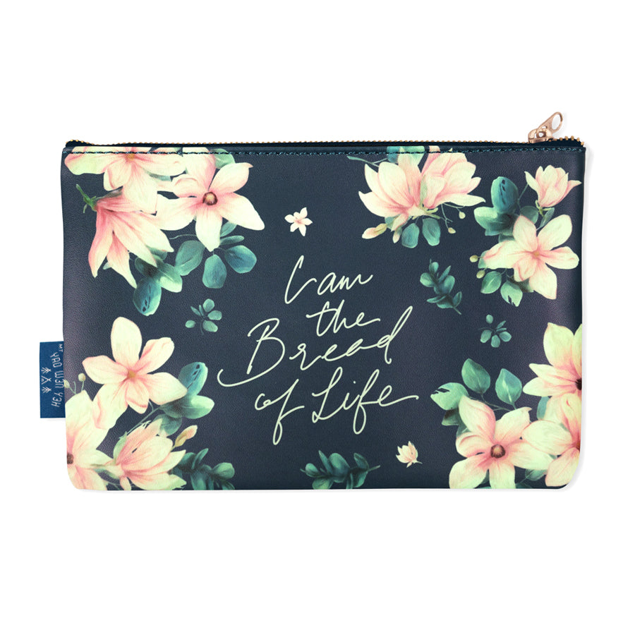 Multipurpose PU Leather pouch in black with floral designs on it. Features bible verse ' I am the bread of life' in white lettering and is great Christian graduation gift idea. The pouch has inner lining, gold zip. Dimensions: 21cm (W) x 14cm (H)