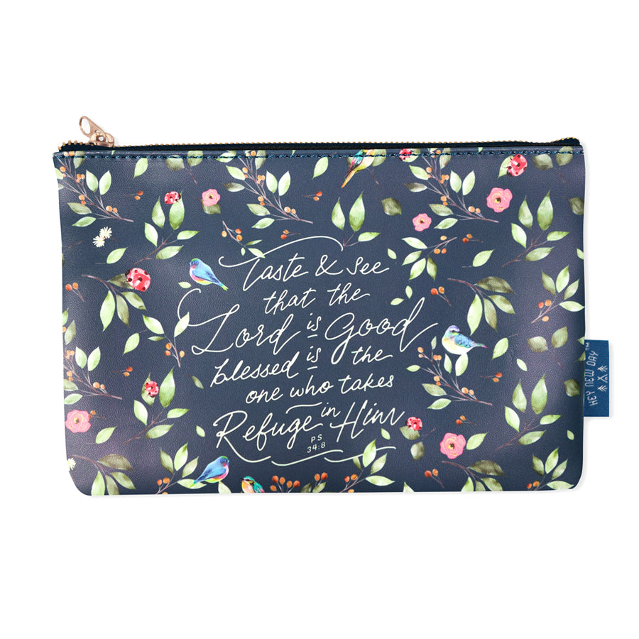 Multipurpose PU Leather pouch in black with garden designs on it. Features bible verse 'Taste and see that the Lord is good ' in white lettering and is great Christian gift idea. The pouch has inner lining, gold zip. Dimensions: 21cm (W) x 14cm (H)