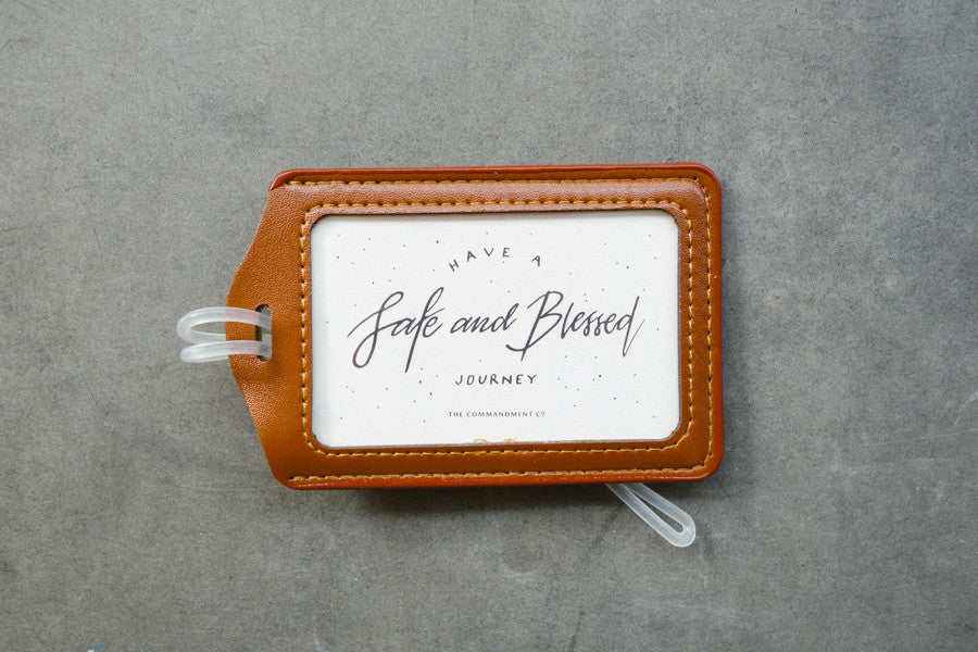 Brown calligraphy luggage tag