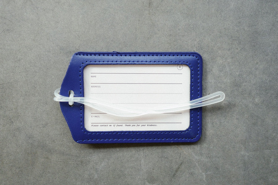 The Commandment Co luggage tag in blue. Have a safe and blessed journey