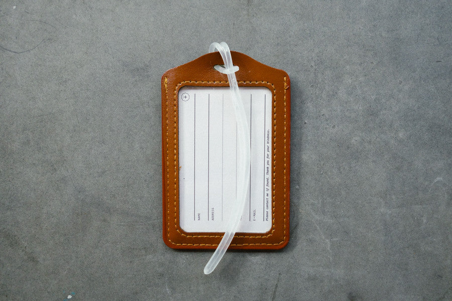 Brown the commandment co luggage tag. You can fill in your name and address